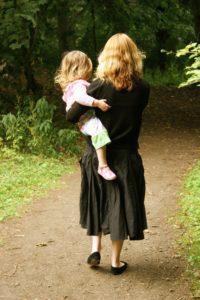 mom-carrying-daughter-facing-away